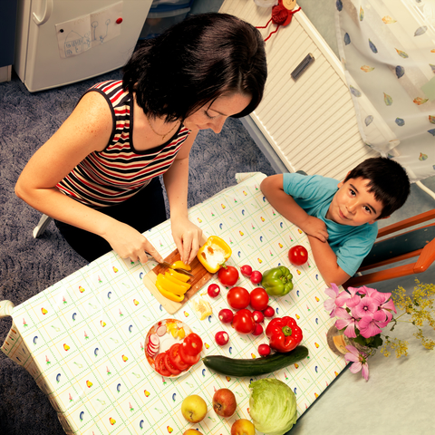 http://www.dreamstime.com/stock-image-mother-son-child-cut-vegetables-meal-food-kitchen-image30615621